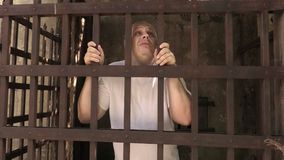 Prisoner in an iron cage stock footage