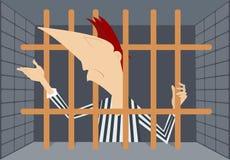 Prisoner. Man stays behind bars Stock Photos