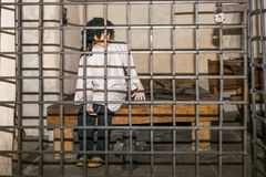 Prisoner in the medieval cell stock images
