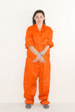 Prisoner. Portrait of female prisoner in orange uniform Royalty Free Stock Image