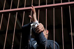 Prisoner in prison. With handcuff Stock Photos