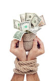 Prisoner of profit - man holding bag of money Royalty Free Stock Images