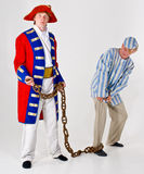 Prisoner and Sailor. Actors costumed as sailor and his prisoner Stock Photo