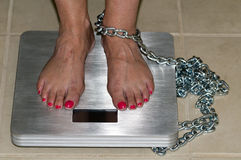 Prisoner of the scale Royalty Free Stock Photography