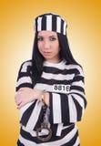 Prisoner in striped uniform on white Royalty Free Stock Photos