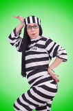 Prisoner in striped uniform on white Stock Image