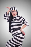 Prisoner in striped uniform on white Stock Images