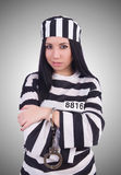 Prisoner in striped uniform on white Royalty Free Stock Photography