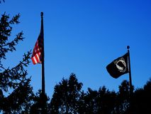 Prisoner of war. The POW MIA flag is an American flag designed as a symbol of citizen concern about United States military personnel taken as prisoners of war stock image