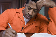 Prisoner Writing In Court Royalty Free Stock Images