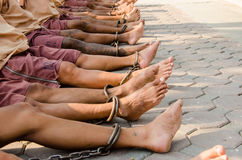 Prisoners. Are bound with chains to the legs. To prevent the escape of the journey to find justice in court. (For tattoo on leg Be made between stints in prison Stock Image