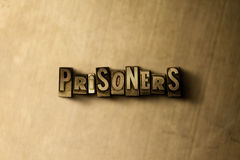 PRISONERS - close-up of grungy vintage typeset word on metal backdrop Stock Photos