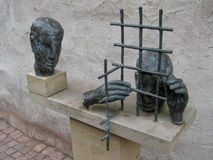 Prisoners. Detail of a statue in the courtyard of the Eisenach castle. The statue represents a prisoner crying behind some prison bars and a second person Royalty Free Stock Photo