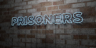 PRISONERS - Glowing Neon Sign on stonework wall - 3D rendered royalty free stock illustration Royalty Free Stock Photo