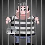 Prisonnier derrière des bars Photos stock