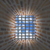 Prisons window and bars in wall from brick Royalty Free Stock Images