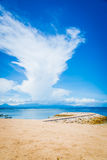 Pristine beach bathed by the Bali Sea Royalty Free Stock Photography