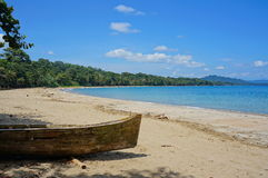 Pristine beach with a dugout canoe Costa Rica. Pristine beach of Punta Uva with an old dugout canoe in foreground, Caribbean coast of Costa Rica, Puerto Viejo de stock images