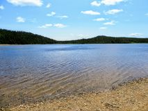 The pristine clear waters of Sandy Pond in Terra Nova National Park, Newfoundland and Labrador, Canada. A nice remote location for a swim in clear fresh lake royalty free stock photography