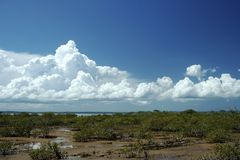Pristine Clouds. A view across the water at Hervey Bay to Fraser Island, Queensland, Australia stock image