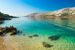 The pristine coastline and crystal clear water of the island of Royalty Free Stock Images