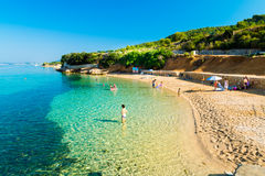 The pristine coastline and crystal clear water of the island of Stock Images
