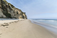 Pristine Dume Cove Beach in Malibu. Dume Cove beach with motion blur water in Malibu, California Stock Images