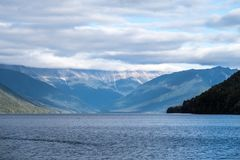 Serene, peaceful landscape of lake and mountain royalty free stock photos