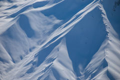 Pristine snow slopes of the Himalayas in India. Royalty Free Stock Images