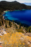 Pristine tahoe shoreline. Blue water of small bay and pristine mountains Stock Image