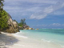 Pristine tropical beach surrounded by granite boulders Stock Images