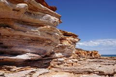 Pristine untouched rugged coastline. Lined by the heavenly blue Indian ocean in Western Australia stock photography