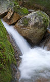 Pristine waterfall amongst moss Royalty Free Stock Photography