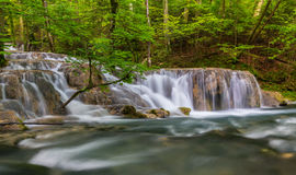 Pristine waterfalls deep in the woods Stock Image