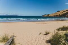Free Pristine Wild Landscape At Clifton Beach In Tasmania, Australia With Wavy Blue Ocean And Golden Sand Next To A Rugged Coastline Stock Photo - 206011520