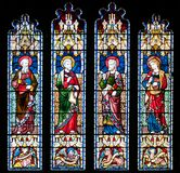 Prittlewell, Essex, UK, 6 July 2018: stained glass window depicting saints at St. Marys church, Prittlewell, Essex. royalty free stock photo