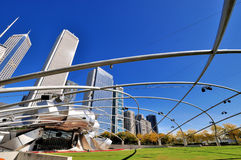 Pritzker Pavilion in Millennium park, Chicago. City buildings and Pritzker Pavilion at Millennium Park in Chicago.  Photo taken in October 5th, 2014 Royalty Free Stock Images