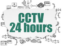 Privacy concept: CCTV 24 hours on Torn Paper Royalty Free Stock Images