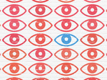 Privacy concept: eye icon on wall background Royalty Free Stock Photos