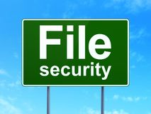 Privacy concept: File Security on road sign background Stock Images