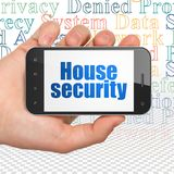 Privacy concept: Hand Holding Smartphone with House Security on display Royalty Free Stock Photos