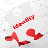 Privacy concept: Identity on puzzle background Royalty Free Stock Images