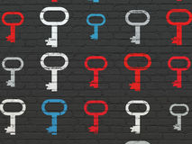 Privacy concept: Key icons on wall background Royalty Free Stock Images