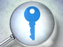 Privacy concept: Key with optical glass on digital Stock Photography