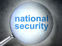 Privacy concept: National Security with optical. Privacy concept: magnifying optical glass with words National Security on digital background Royalty Free Stock Images