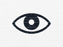 Privacy concept: Eye on wall background Royalty Free Stock Photo