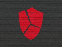 Privacy concept: Broken Shield on wall background. Privacy concept: Painted red Broken Shield icon on Black Brick wall background Stock Images