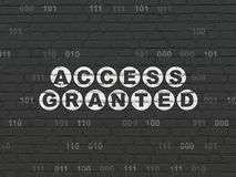 Privacy concept: Access Granted on wall background. Privacy concept: Painted white text Access Granted on Black Brick wall background with Binary Code Royalty Free Stock Photography