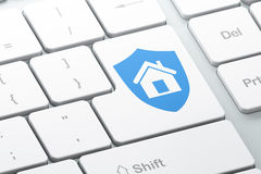Privacy concept: Shield on computer keyboard background Stock Photography