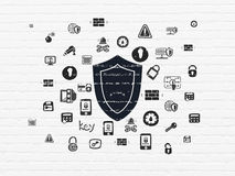 Privacy concept: Shield on wall background Royalty Free Stock Images
